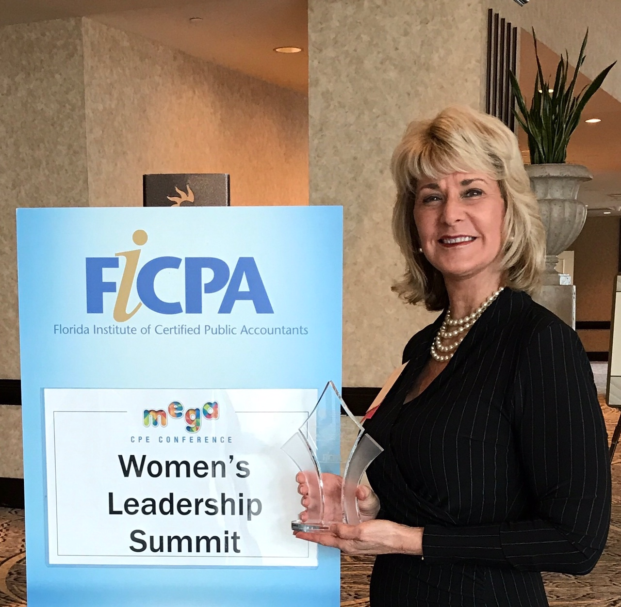 Gail with Award for FICPA
