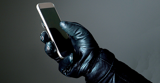 Leather glove holding a phone